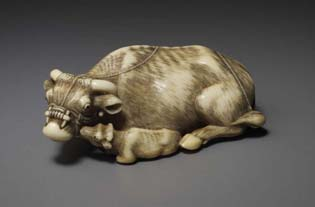 The ivory netsuke chosen to represent 2009 is a magnificently carved cow, 7.5 cm long, 45 grams, with her calf, the latter licking the mother's muzzle, the long rope falling over the parent's back, the ivory exquisitely patinated, both eyes inlaid in some dark material, probably horn signed Tomotada (Kyoto-school), mid 18th century.